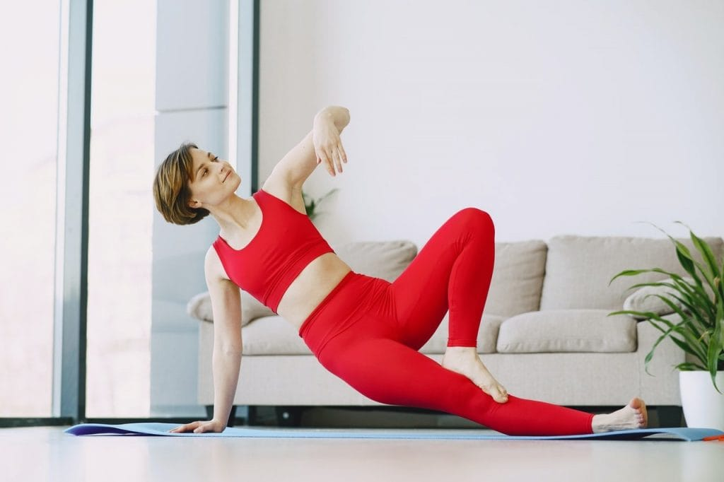 young woman performing yoga exercise at home 4148933 min