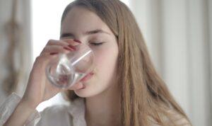 lady drinking warm water