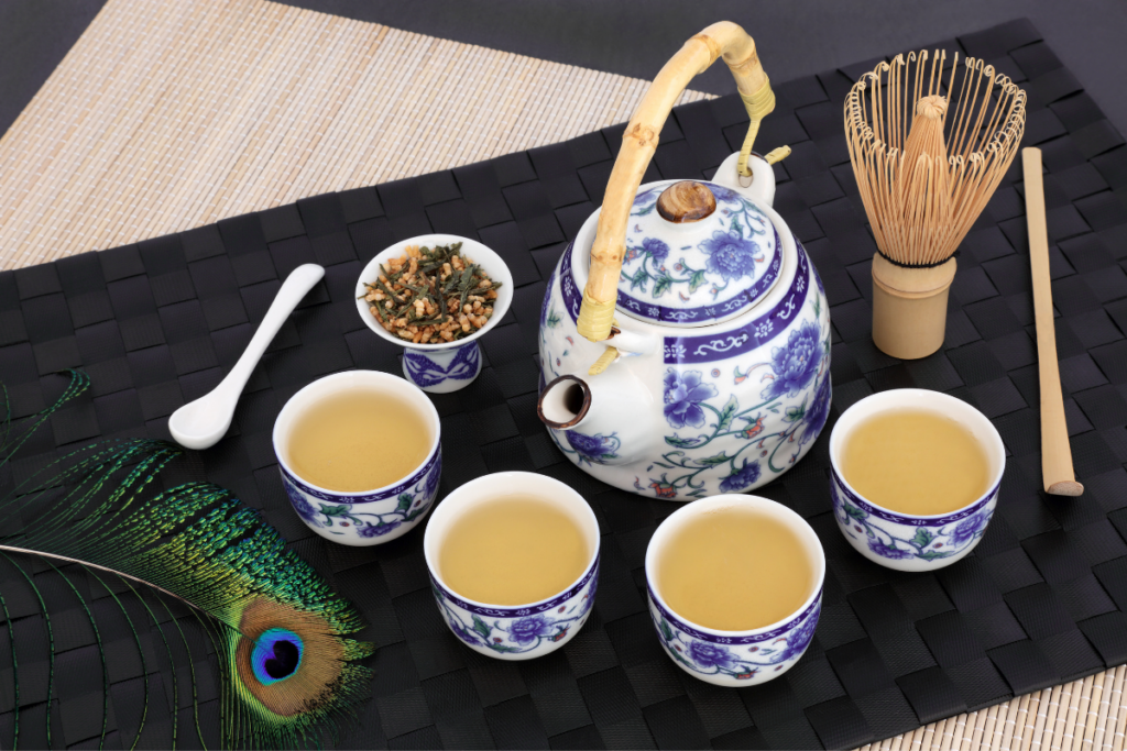 a teapot with cups of genmaicha brown rice tea