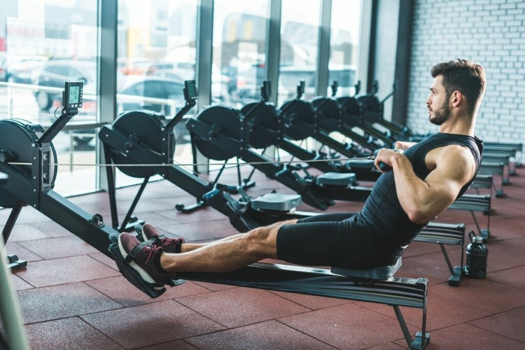 using the rowing machine in a gym